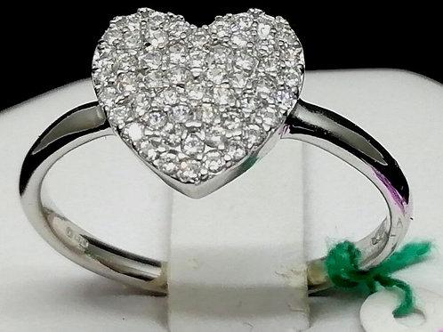 Anello in oro bianco 9 CT.  325/°° a forma di cuore con zirconi incassati