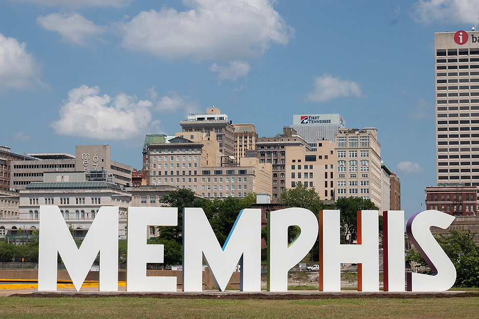 Large letters spelling 'Memphis' with a city skyline in the background