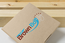 mailing-box-mockup-with-a-wooden-backgro