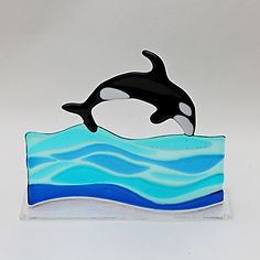 Diving Orca on fused glass wave