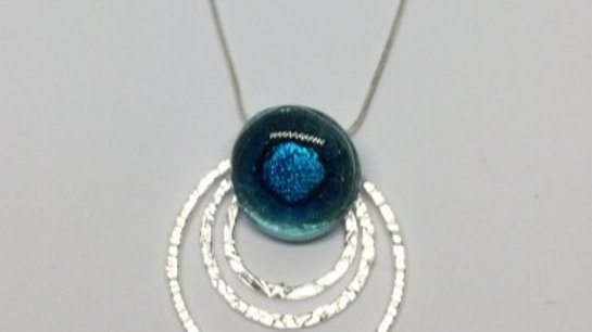 Glass pendant with 3 silver textured rings