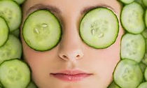 woman with soothing cucumbers on eyes