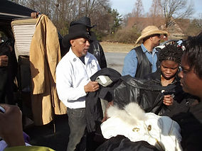 black Cowboys and Cowgirls Giving coats for holidays