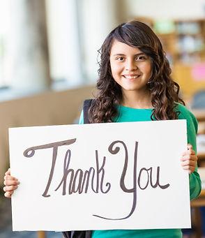 Hispanic_girl_with_thank_you_sign.jpg