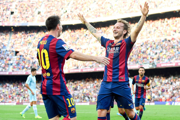 Messi and Rakitic celebrating
