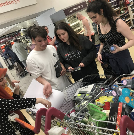 Young Neighbours collect £500 worth of goods for refugees.