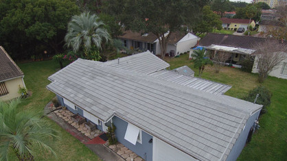 new flat boral roof tiles on cottage