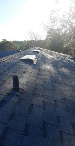 sunset view of new roof from amc roofing
