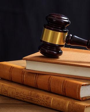 judge-gavel-on-law-books-wooden-desk-Alan Jacobs