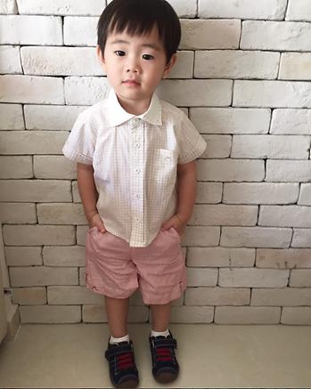 Little boy wearing Chateau de Sable outfit