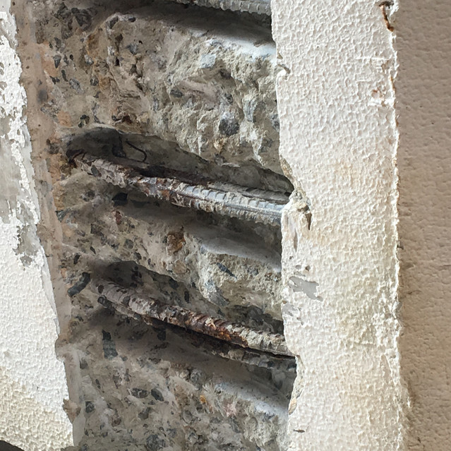 Rusted steel reinforcement is symptomatic of concrete cancer (residential strata complex, West Perth)