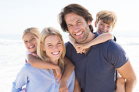 Parents giving piggyback ride to kids at