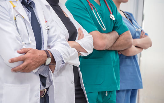 A group of doctors and nurses standing a
