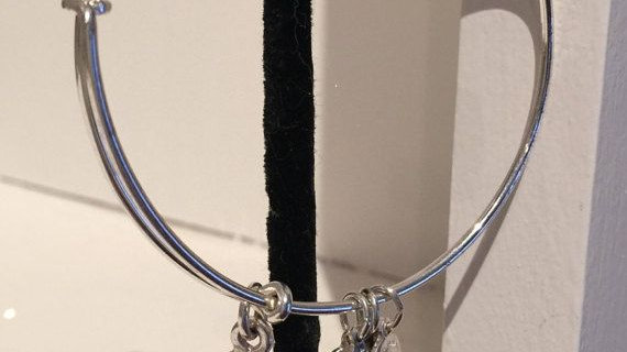 Silver tone adjustable bracelet with charms