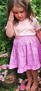 handmade childrens clothes - handmde skirt in pink dinosaur fabric