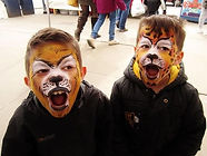 Lion and leopard face painting (in Morpeth) with gold glitter