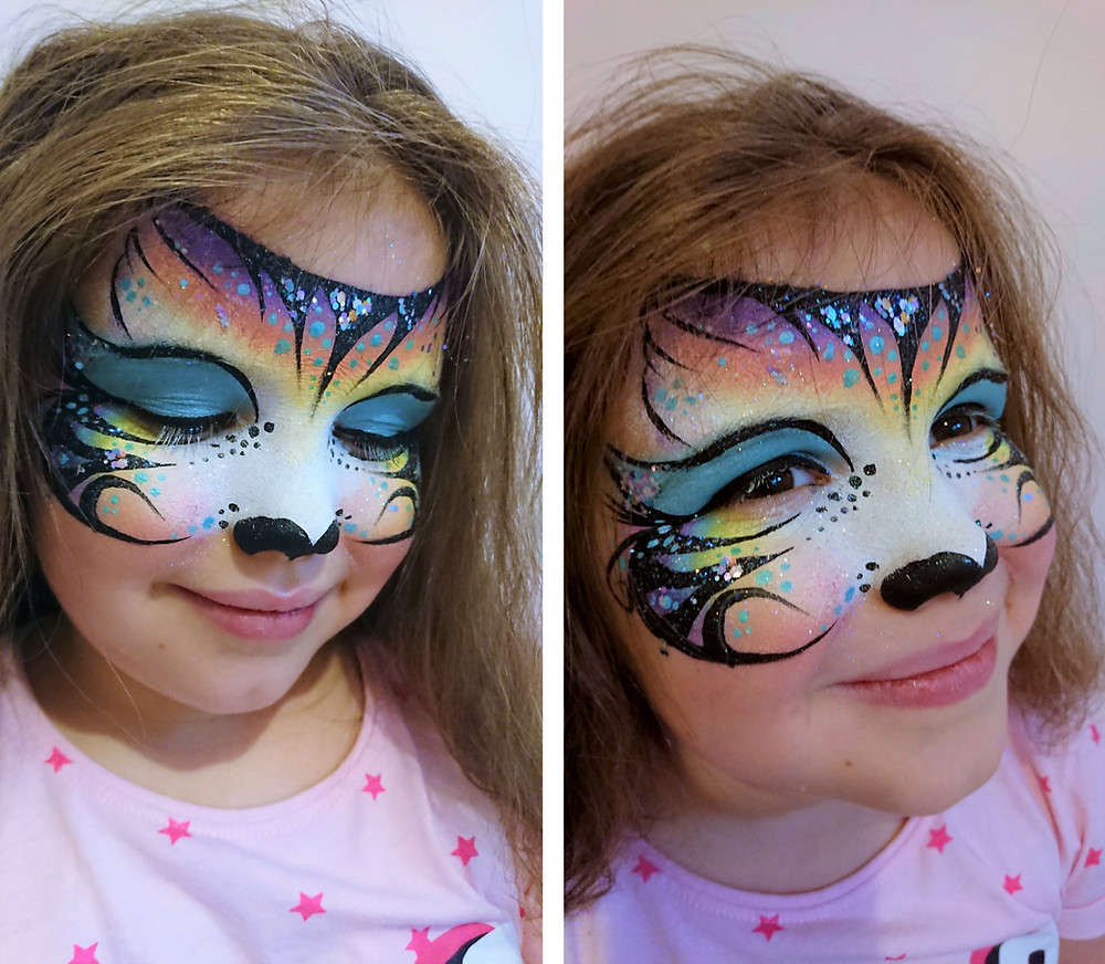 Girl with colourful tiger face paint design