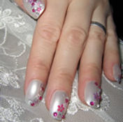 Wedding nail art design (in Blyth) White painted nails with pink gemstones and flowers