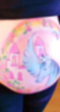 Baby bump painting (gestational art) with rainbows, princess and pegasus