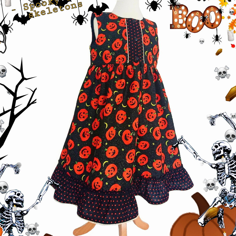 Front fastening party dress in glittery 'Little Pumpkins' fabric