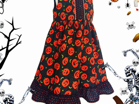 Front fastening party dress in our 'Little Halloween Pumpkins' fabric