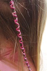 Hairbraiding in Newcastle using glitter threads in shades of pink