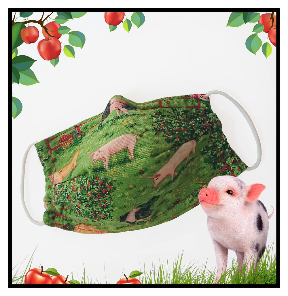 Face covering/mask in green orchard with different pig breeds cotton fabric