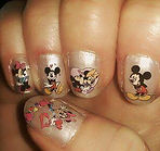 Disney nail art design (in Newcastle) Painted nails with Mickey and Minnie Mouse nail art stickers sealed with a topcoat