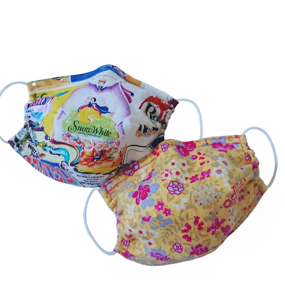 Face coverings made from two layers of woven cotton with a thin layer of non woven interfacing in between and a sewn in nose clip. Available for children and adults