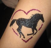 Galloping horse glitter tattoo (in Gateshead) in black with glitter purple heart