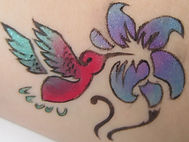 Bird and flower tattoo in temporary ink