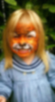 Fun tiger face paining (in Gosforth) with orange glitter