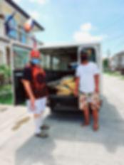 Lin Travers with Barangay truck.jpg