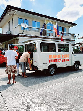 Barangay Cutud vehicle loaded with rice.