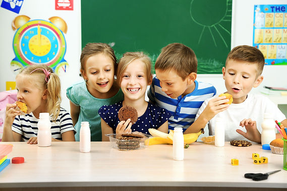 Cute children at lunch time in classroom.jpg