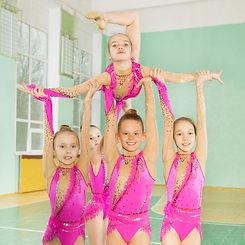Girls carrying out routine in rhythmic gymnastics.jpg