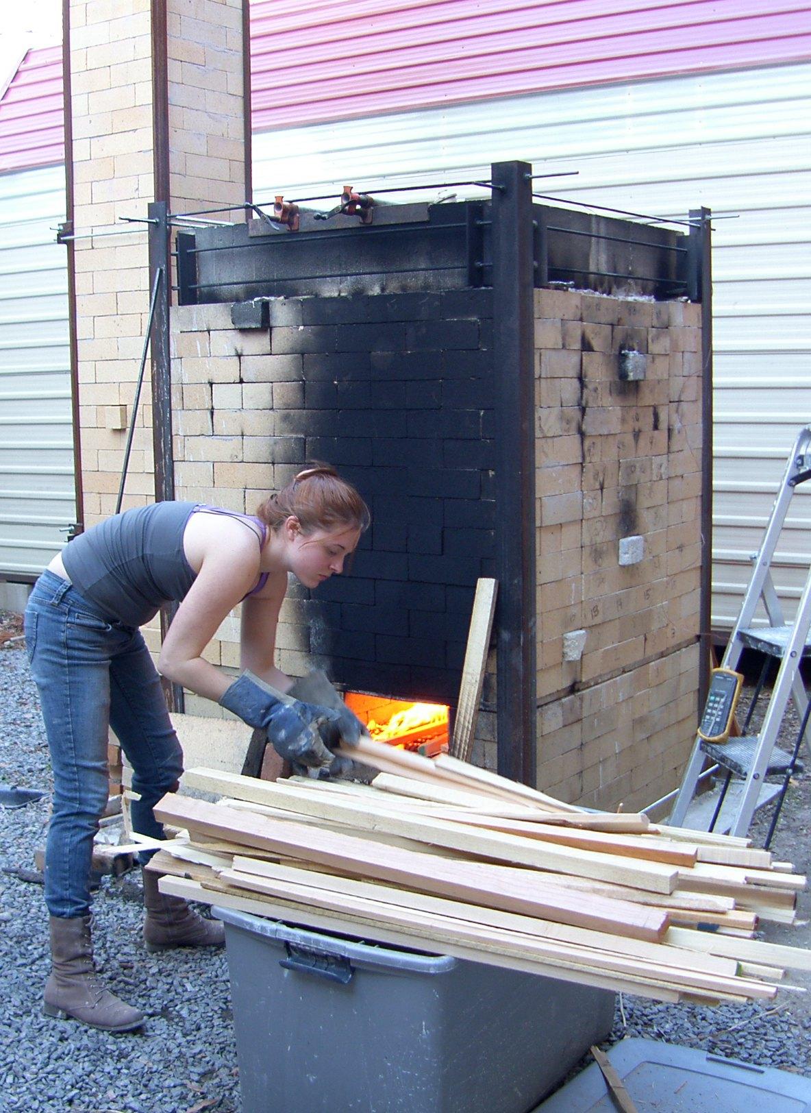 Hannah wood firing at UALR