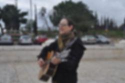 Robin singing on the tayelet.JPG