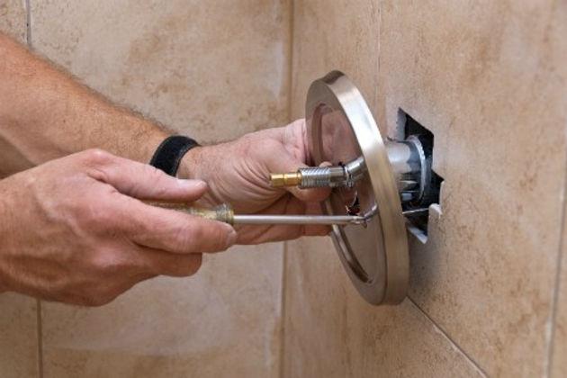 Man fitting Shower Mixer