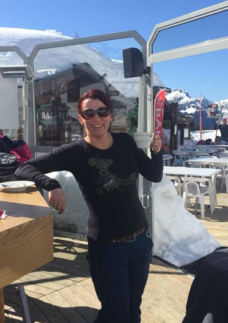 Having a ski break at the umbrella bar, Chatel, France