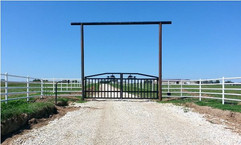 Black gate white fence.jpg
