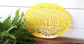 Landeis yellow oval name sign.jpg