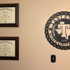 tarleton seal customer pic with diplomas