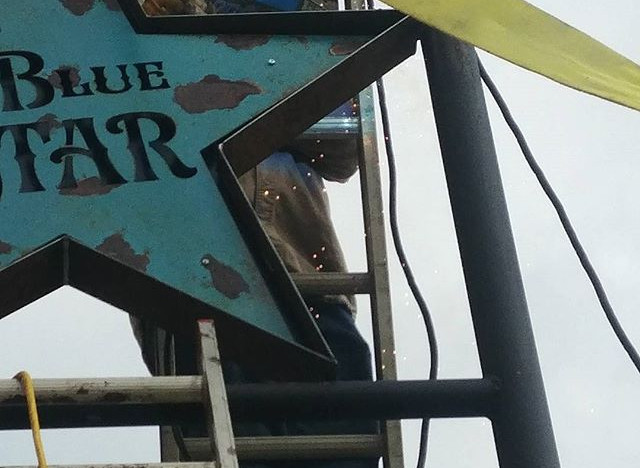 Blue star installing sign.jpg