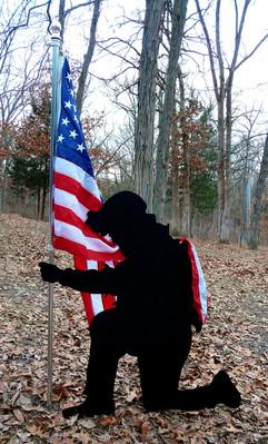 Kneeling with flag.jpg