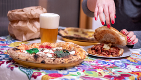 Cucina conviviale: pizza, pescato e buon vino