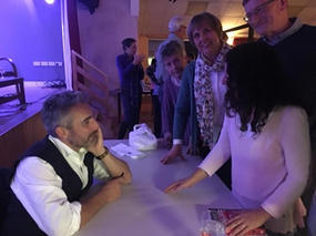 Matthew signing books with Jan and Ruth looking on