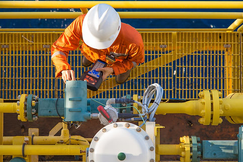 Offshore oil rig worker calibrating cori