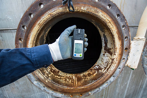 Worker hand holding gas detector inspect