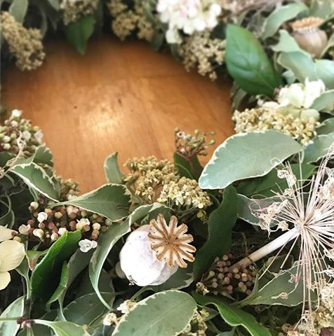 A Christmas wreath made from dried English flowers